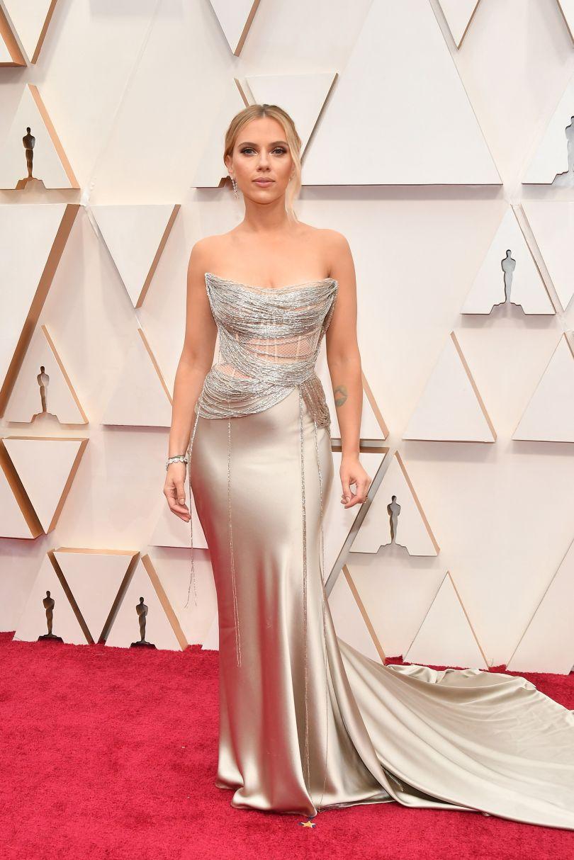 Scarlett Johansson in a golden dress with bare shoulders
